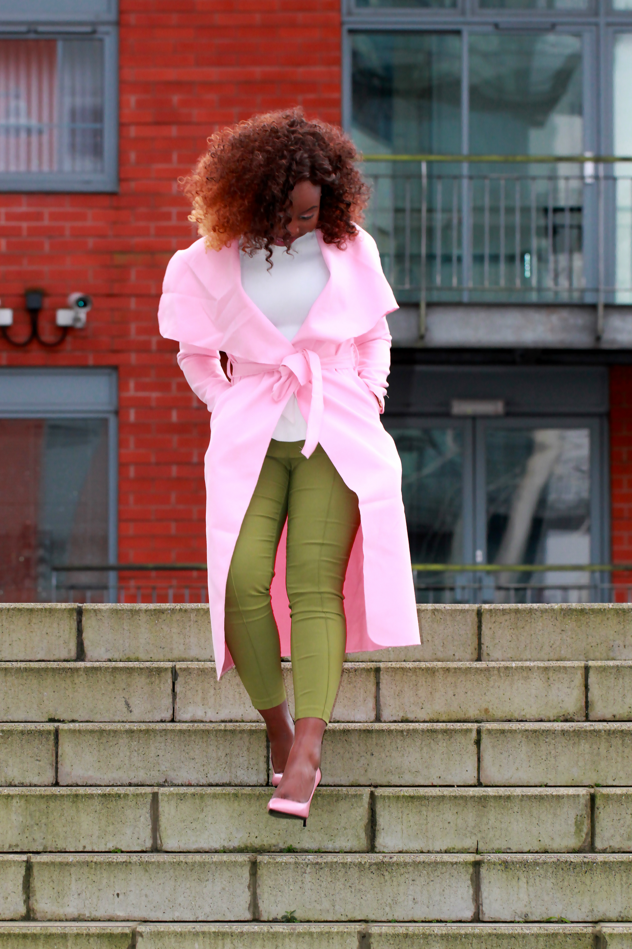 green trousers pink cape coat a